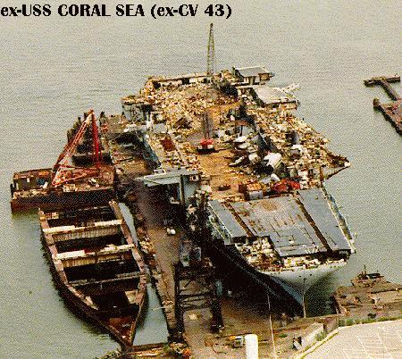 'ex-Coral Sea half-scrapped, 25 August 1994.' from the web at 'http://www.hazegray.org/navhist/carriers/coralsea/coral04.jpg'