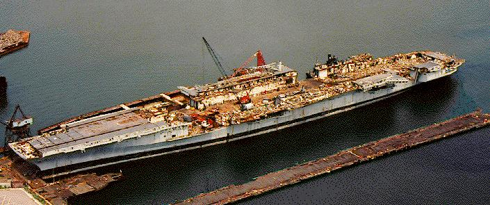 'ex-Coral Sea half-scrapped, 25 August 1994.' from the web at 'http://www.hazegray.org/navhist/carriers/coralsea/coral05.jpg'